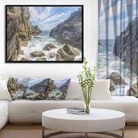 Designart 'Sea Waves Hitting Rocky Shore' Modern Seascape Framed Canvas Artwork