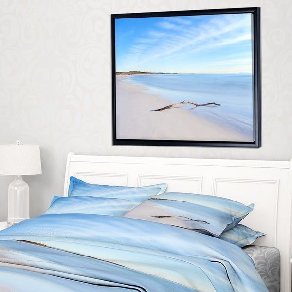 Designart 'Wood Branch on White Beach' Modern Seascape Framed Canvas Artwork