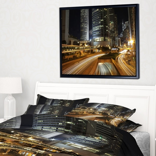 Designart 'Skyscrapers and Busy Traffic' Cityscape Framed Canvas Art Print