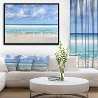 Designart 'Tranquil Beach under White Clouds' Modern Seascape Framed Canvas Artwork