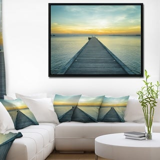 Designart 'Wood Pier into the Yellow Blue Sea' Wooden Sea Bridge Framed Canvas Wall Art