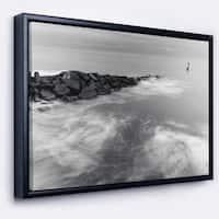 Designart 'Milky Waves Splashing Over Rocks' Modern Seascape Framed Canvas Artwork