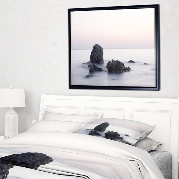 Designart 'Rocks in the Sea Black and White' Seashore Framed Canvas Art Print