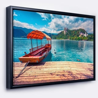 Designart 'Boat in Lake Bled In Julian Alps' Large Landscape Framed Canvas Art Print
