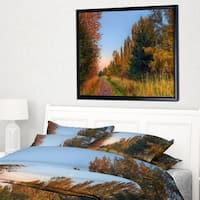 Designart 'Road Through Fall Forest' Extra Large Landscape Framed Canvas Art Print