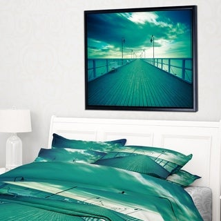 Designart 'Blue Seascape With Wooden Pier' Bridge Framed Canvas Art Print