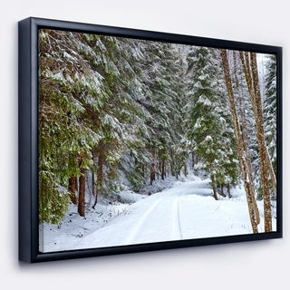 Designart 'Snowy Road in the Forest' Landscape Framed Canvas Art Print