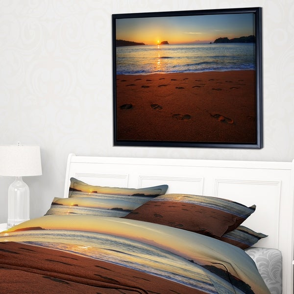 Designart 'Foot printed Sandy Ocean Beach' Seashore Framed Canvas Art Print