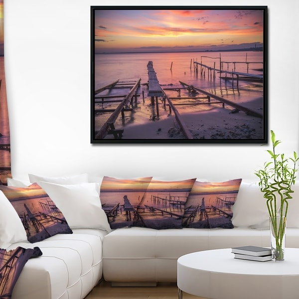 Designart 'Fishing Pier in Sea at Sunset' Seashore Framed Canvas Art Print