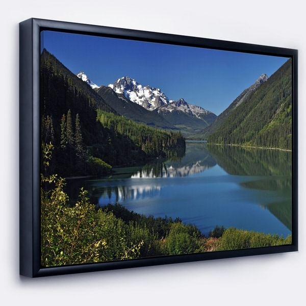 Designart 'Calm Clear Lake with Mountains' Extra Large Landscape Framed Canvas Art Print