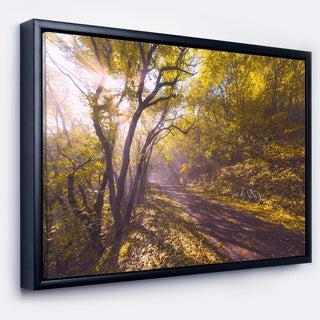 Designart 'Bicycle Ride in Fall Forest' Landscape Framed Canvas Art Print