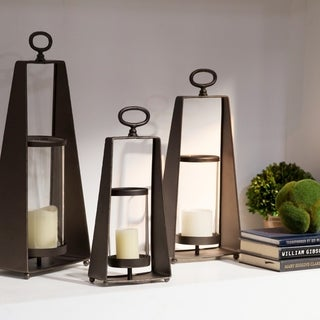 UTC38825: Metal Round Lantern with Oval Ring Handle and Glass Cylinder Holder Center Set of Three Metallic Finish Dark Brown