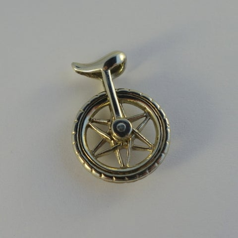 Handmade White Brass Spinning Unicycle Pendant (Indonesia) - Silver