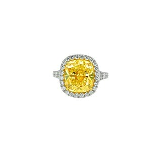 Platinum and Yellow Gold Diamond Ring with Main 7.65 Carat Fancy Yellow Diamond surrounded by 1.60 Carat of Diamonds