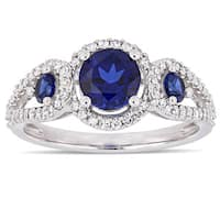 Miadora Signature Collection 10k White Gold Created Blue Sapphire and 1/3ct TDW Diamond 3-Stone Halo Crossover Engagement Ring