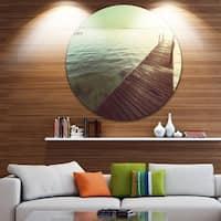Designart 'Wooden Boardwalk over Clear Waters' Sea Bridge Round Wall Art