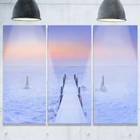 Designart - Jetty in Frozen Lake Netherlands - Wooden Sea Bridge Glossy Metal Wall Art