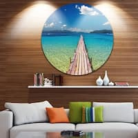 Designart 'Wooden Pier in Tropical Paradise' Seascape Photo Round Metal Wall Art