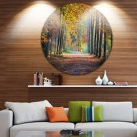 Designart 'Wide Pathway in Yellow Fall Forest' Landscape Photo Round Metal Wall Art
