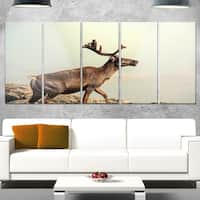 Designart 'Reindeer on Top of the Mountain' Extra Large Animal Metal Wall Art