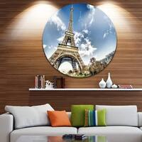 Designart 'Eiffel Under Dark Cloudy Sky' Landscape Photo Disc Metal Wall Art