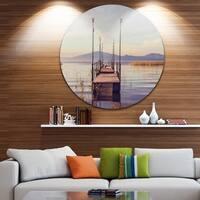 Designart 'Wooden Boardwalk to Clear Sea Water' Sea Bridge Large Disc Metal Wall art
