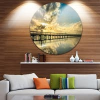 Designart 'Long Jetty Foreshore Reserve with Clouds' Sea Bridge Circle Wall Art
