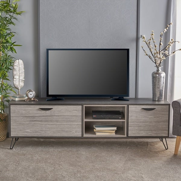 Isadora Mid Century Modern Faux Wood TV Stand by Christopher Knight Home. Opens flyout.