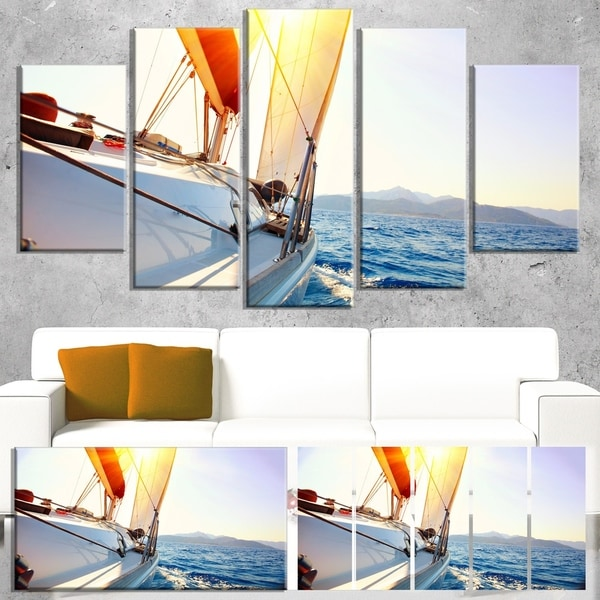 Designart 'Sailboat Sailing in the Blue Sea' Large Seashore Canvas Wall Art