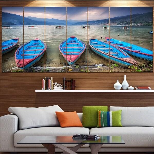 Designart 'Row of Blue Boats in Pokhara Lake' Boat Wall Artwork on Canvas