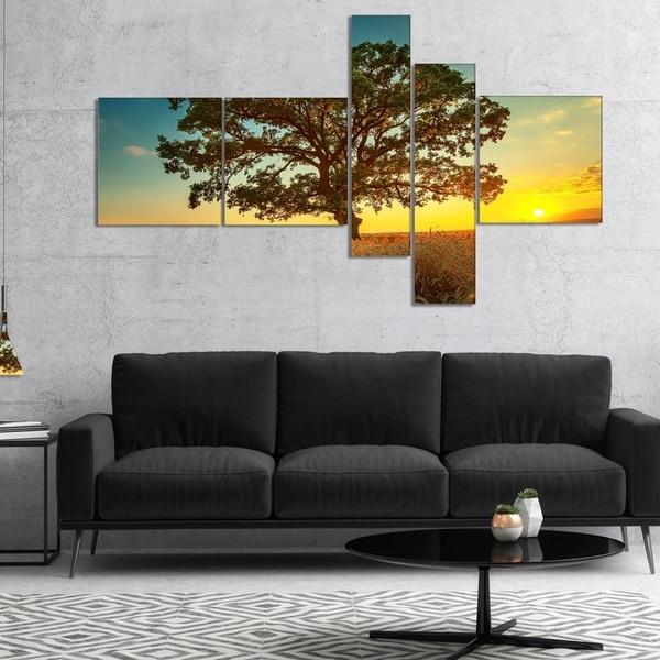 Designart 'Big Green Tree in Summer Field' Trees Canvas Art Print