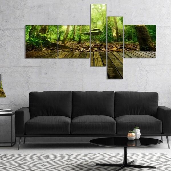 Designart 'Wooden Platform in Green Forest' Landscape Photography Canvas Print