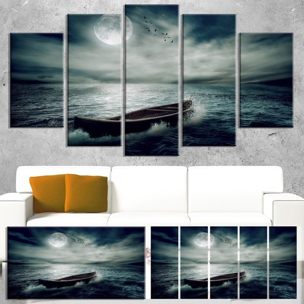 Designart 'Boat Drifting Away After Storm' Modern Seashore Canvas Wall Art Print