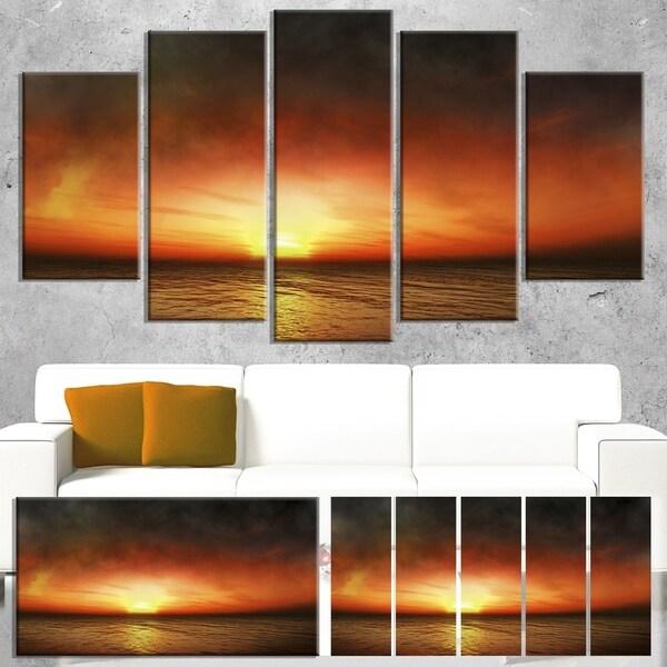 Designart 'Fiery Sunset Beach under Cloudy Sky' Modern Seashore Canvas Art