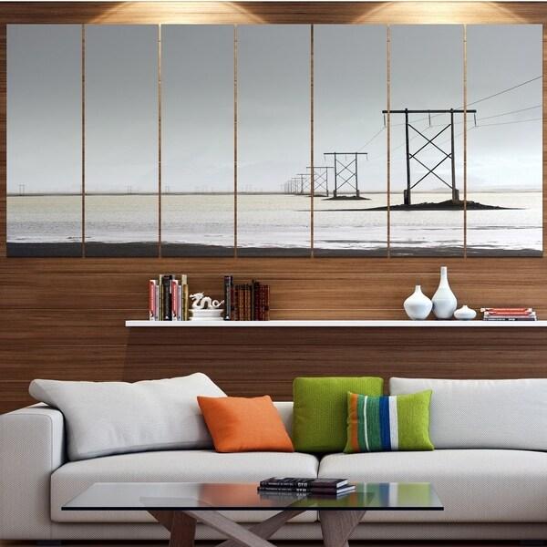 Designart 'Electricity Pylons over Lagoon' Landscape Canvas Wall Artwork