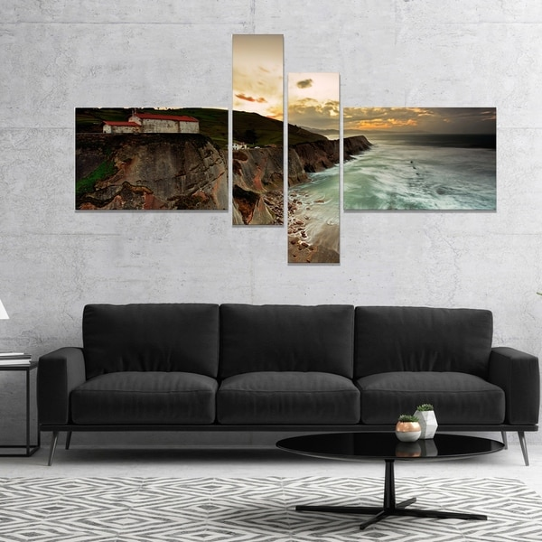 Designart 'Ocean Hitting Rocky Hill' Seashore Photo Canvas Art Print