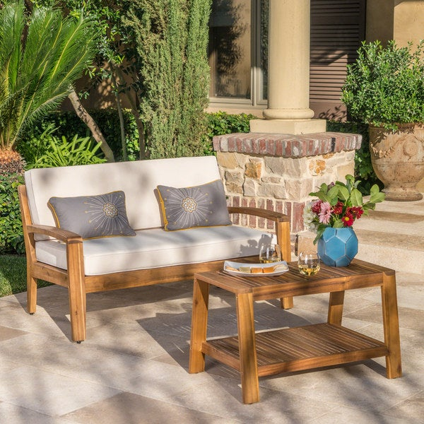 Grenada Outdoor 2-piece Acacia Wood Loveseat and Coffee Table Set with Cushions by Christopher Knight Home. Opens flyout.