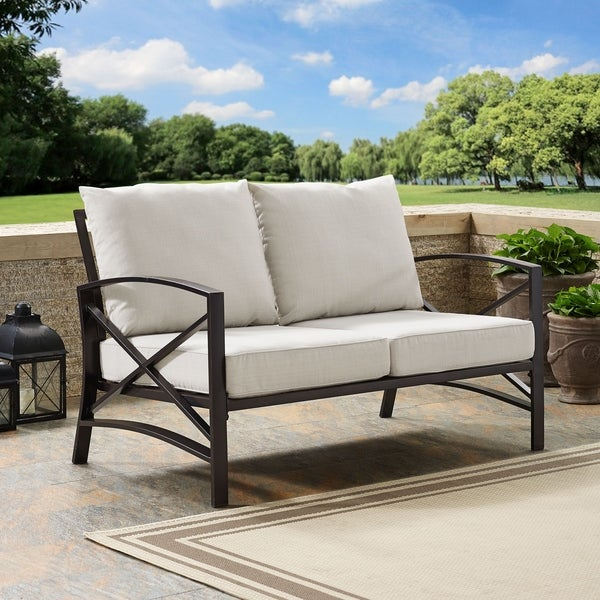 Shop Kaplan Loveseat In Oiled Bronze With Oatmeal Universal Cushion