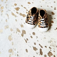 Pergamino Gold on White Cowhide Rug