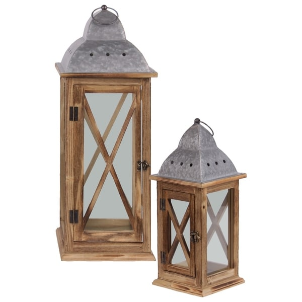 "UTC31444: Wood Lantern with Metal Finial Top, Ring Handle, and, ""X"" and Glass Design Body Set of Two Natural Finish Brown"