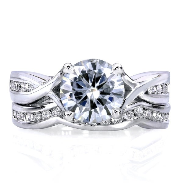 Annello by Kobelli 14k White Gold 1 1/2ct TGW Round Moissanite and Channel-set Diamond Trellis Bow Bridal Rings (DEF/VS, GH/I). Opens flyout.