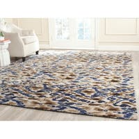 Safavieh Couture Hand-Knotted Luxor Eclectic Cream / Blue Rayon Rug - 9' x 12'
