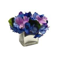 Blue arrangement in a mercury glass vase