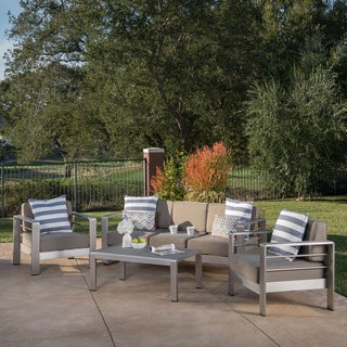Link to Cape Coral Outdoor Aluminum 4-piece Chat Set with Cushion by Christopher Knight Home Similar Items in Patio Sets