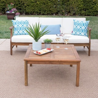 Link to Perla Outdoor Acacia Wood 4-piece Sofa and Table Set with Cushions by Christopher Knight Home Similar Items in Outdoor Sofas, Chairs & Sectionals