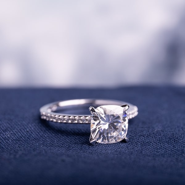 14k White Gold 2ct TGW Cushion Moissanite and 1/10ct TDW Diamond Engagement Ring by Miadora. Opens flyout.