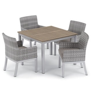Oxford Garden Travira 5-piece 39-inch Tekwood Vintage Dining Table & Argento Resin Wicker Armchair Set - Stone Cushions