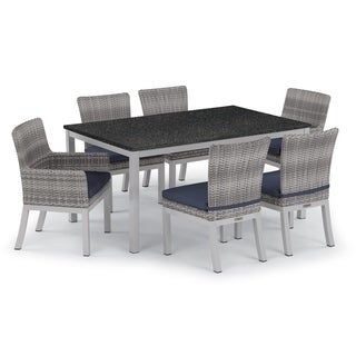 Oxford Garden Travira 7-piece 63-in x 40-in Lite-Core Table & Argento Resin Wicker Arm & Side Chair Set - Midnight Blue Cushions