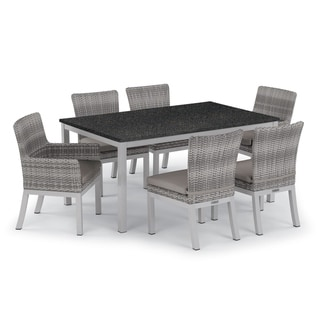 Oxford Garden Travira 7-piece 63-in x 40-in Lite-Core Table & Argento Resin Wicker Arm & Side Chair Set - Stone Cushions