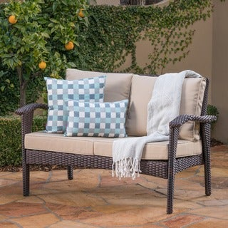 Link to Honolulu Outdoor Wicker Loveseat with Cushions by Christopher Knight Home Similar Items in Outdoor Sofas, Chairs & Sectionals